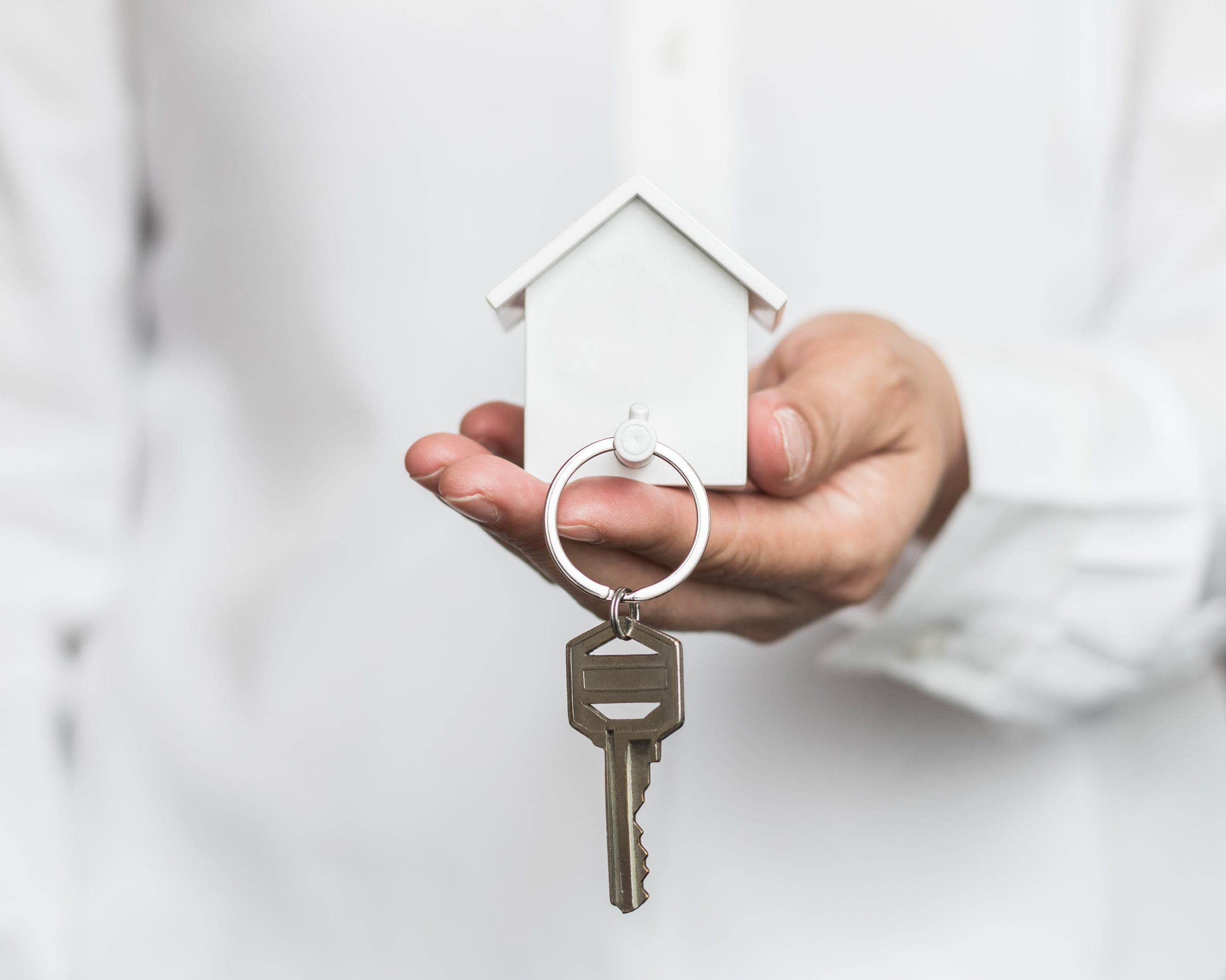 House,Key,In,Home,Insurance,Broker,Agent's,Hand,Protection,Or